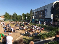 On the green outside Riverside showing people on deck chairs enjoying themselves