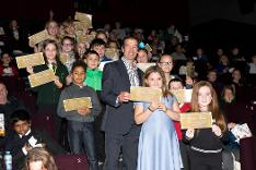 Breckland Council's Leader, Cllr William Nunn, with 'golden ticket' winners, who were selected by their schools to attend pre-launch film screening